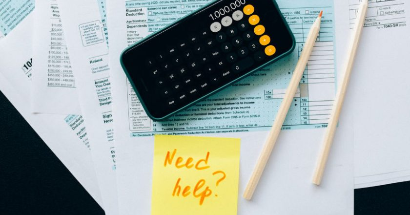 Tax papers, calculator, payroll services