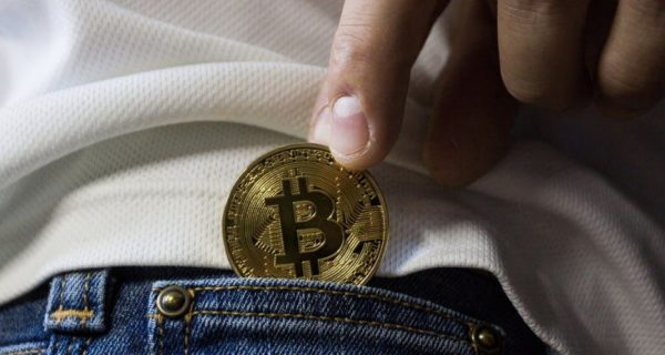 Bitcoin being slipped into a back pocket