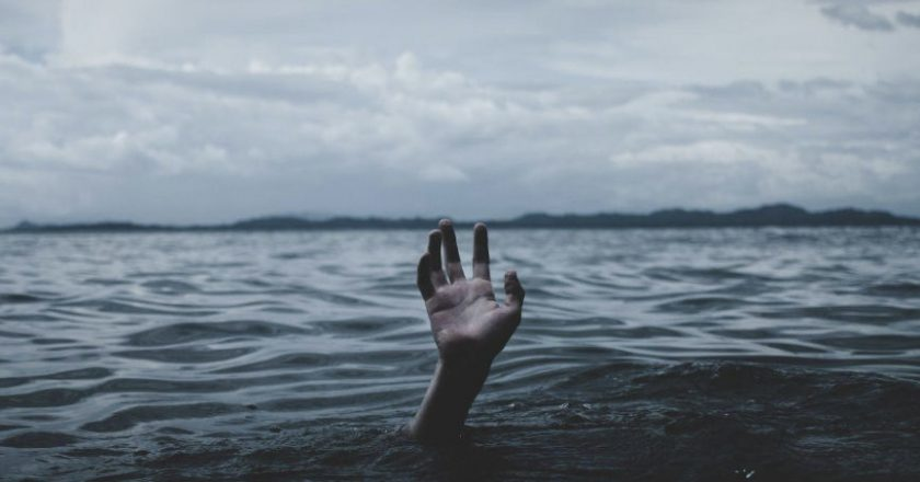 Hand emerging from sea