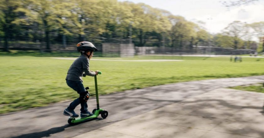 Child Riding an Electric Scooter