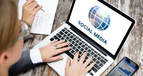 Laptop displaying social media