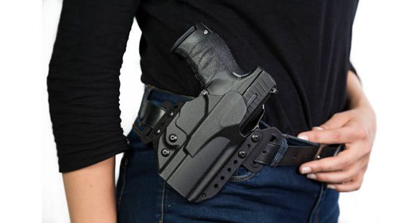 Woman wearing gun holster