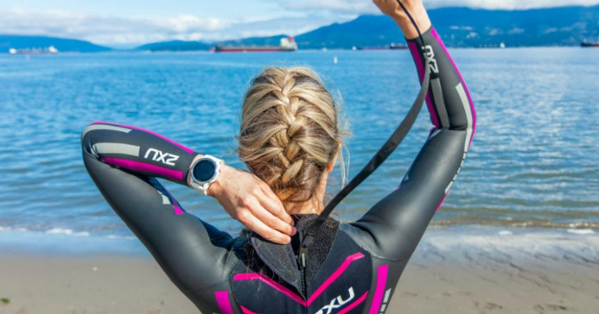 Woman in a wetsuit at the beach